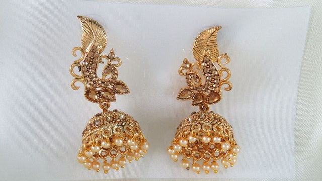 stone studded peacock jhumka style gold plated earrings