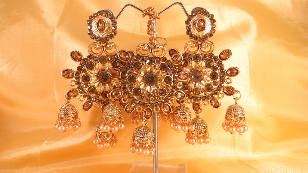 stone studded jhumka drop gold plated earrings