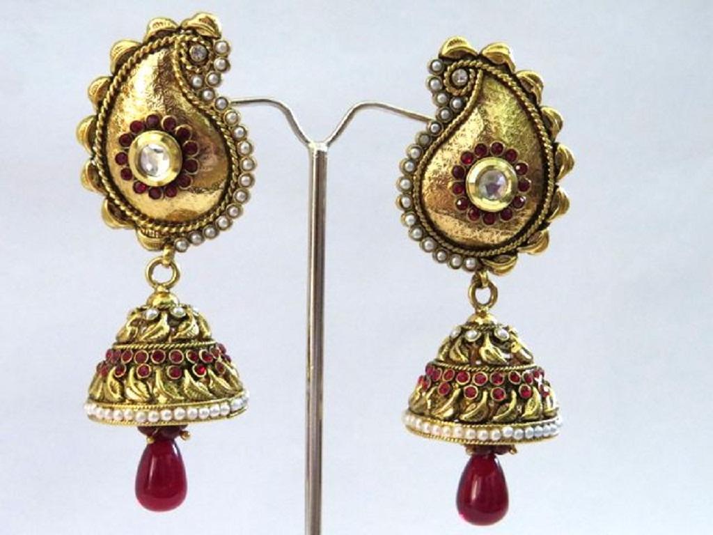 stone studded jhumka earrings