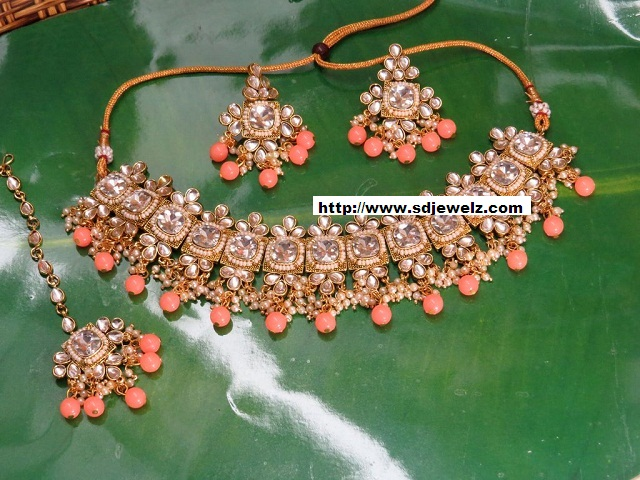 stone studded kundan necklace set in golden and white cheap indian costume jewelry