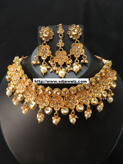 stone studded traditional indian kundan necklace set in golden and green