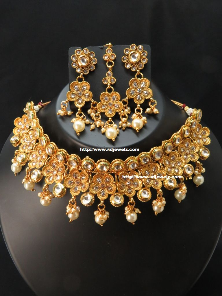 floral style kundan necklace set in gold polish