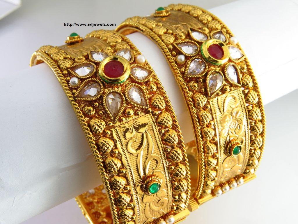 stone studded bangle set in golden